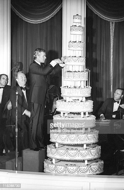 Johnny Carson host of the Tonight Show cuts the cake at a party after taping the 10th anniversary show on September 30 1972 in Los Angeles California