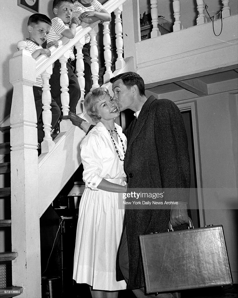 Johnny Carson kissing his wife before leaving for the studio : News Photo