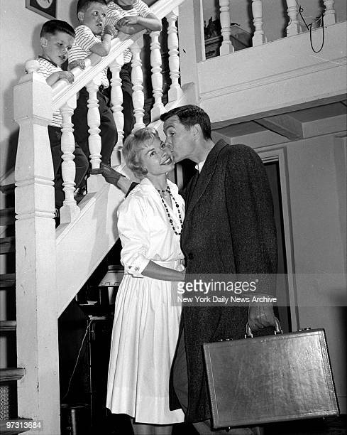 Johnny Carson kissing his wife before leaving for the studio as his sons look on at his home Birch Hill Estate Winfield Ave Harrison NY