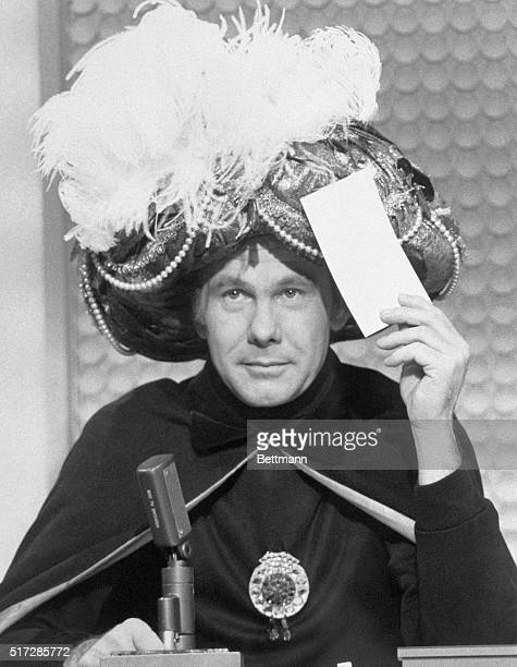 "Johnny Carson plays the part of ""Carnac the Magnificent"" during an episode of The Tonight Show with Johnny Carson."