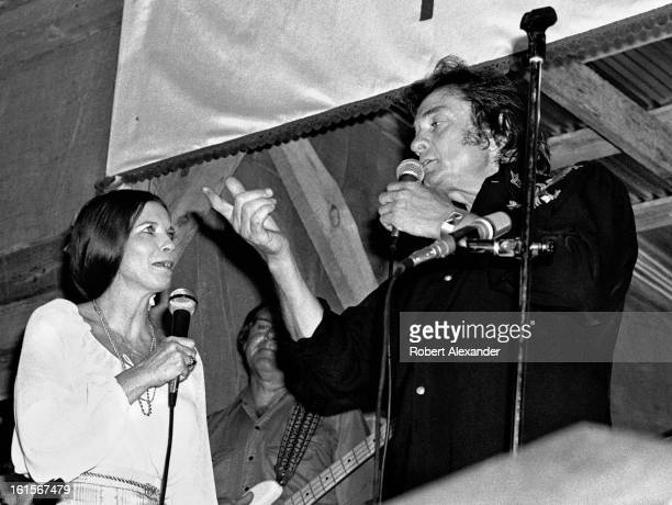 Johnny Cash and his wife June Carter Cash perform at the AP Carter Memorial Festival in Maces Springs Virginia in August 1977 AP Carter was the...