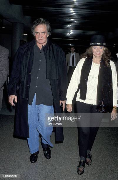Johnny Cash and June Carter Cash during Johnny Cash Departing for Memphis November 18 1992 at Los Angeles International Airport in Los Angeles CA...