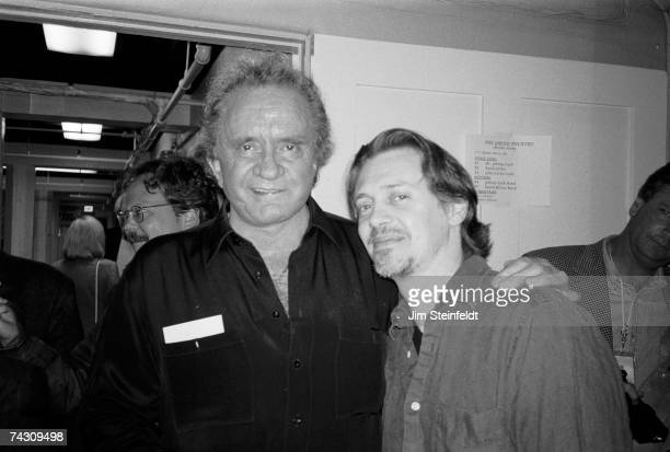 Johnny Cash and Steve Buscemi pose for a photograph backstage at the Greek Theatre in Los Angeles California on June 14 1997