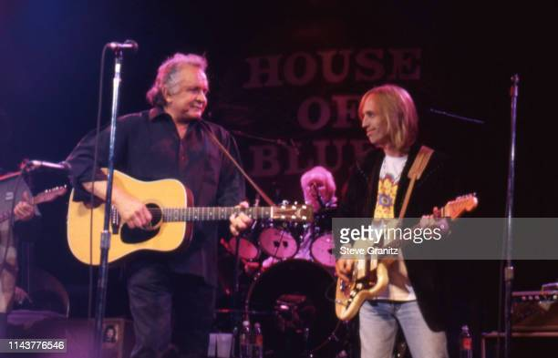 Johnny Cash and Tom Petty perform onstage on February 25 1996 at the House of Blues in Los Angeles California United States n