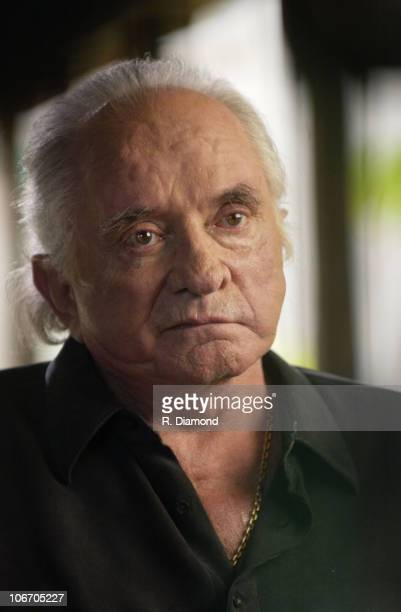 Johnny Cash during Johnny Cash and June Carter Cash on the set of CMT INSIDE FAME at their home in Jamaica at Cinnamon Hill in Montego Bay Jamaica