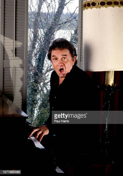 Johnny Cash impersonates Jerry Lewis playing the piano at home September 12 1988 Nashville Tennessee