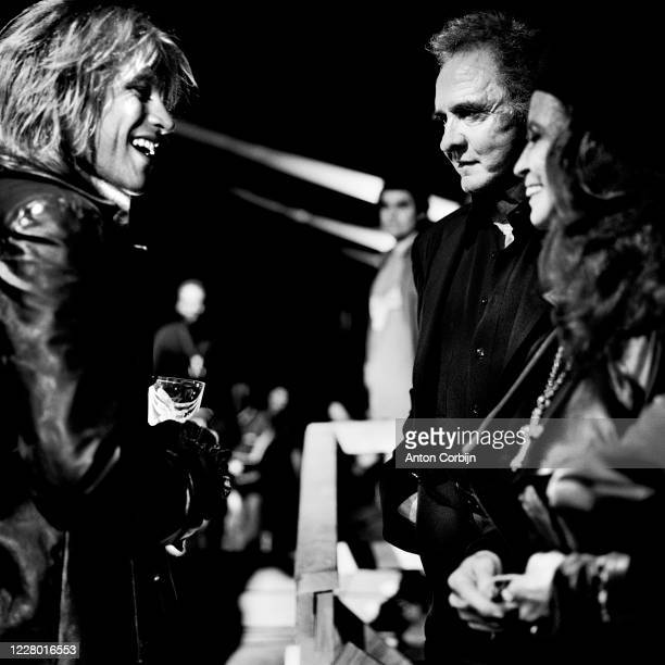 Johnny Cash June Carter Cash and Jon Bon Jovi are photographed during preparations for the first concert for the Rock and Roll Hall of Fame Museum on...