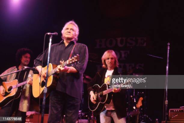 Johnny Cash Mike Campbell and Tom Petty perform onstage on February 25 1996 at the House of Blues in Los Angeles California United States n