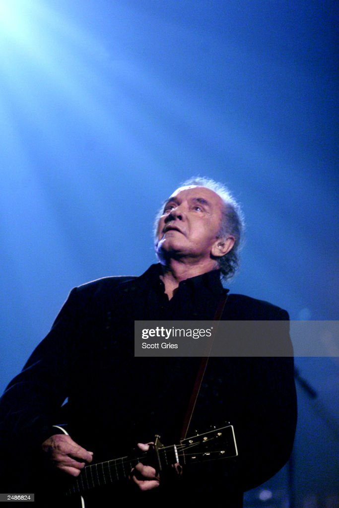 Johnny Cash performs during an all-star Tribute to Johnny Cash at the Hammerstein Ballroom in New York City that is scheduled to air on TNT April 18, 1999. Johnny Cash died September 12, 2003 in a hospital in Nashville, Tennessee while being treated for a stomach complaint. He was 71.