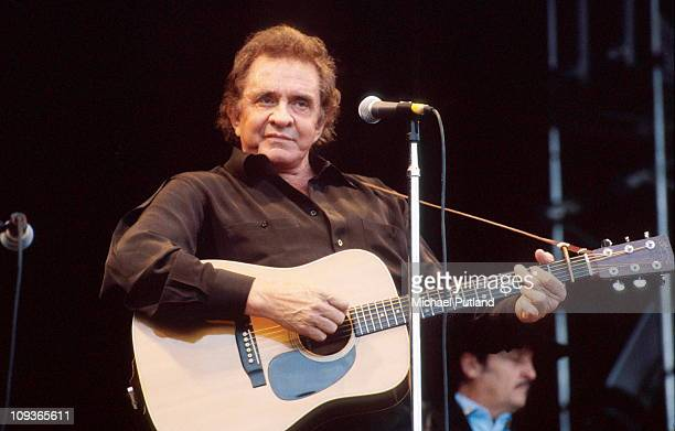 Johnny Cash performs on stage at Glastonbury Festival, June 1994.