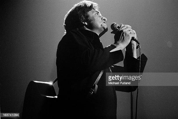 Johnny Cash performs on stage at the Royal Albert Hall London September 1972