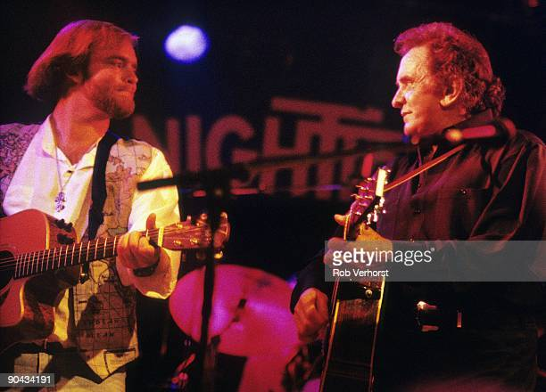 Johnny Cash performs on stage with his son John Carter Cash at the Nighttown in Rotterdam Netherlands on June 30 1994