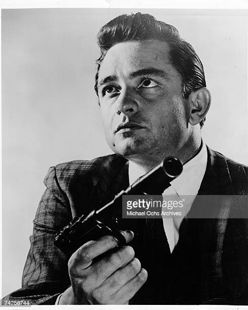 Johnny Cash poses for a portrait for a publicity shot for his movie debut in 'DoortoDoor Maniac' aka 'Five Minutes To Live' on Auust 3 1960 in Los...