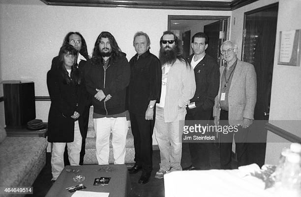 Johnny Cash poses with Rick Rubin Lou Robin and others backstage at the Greek Theatre in Los Angeles California on June 14 1997