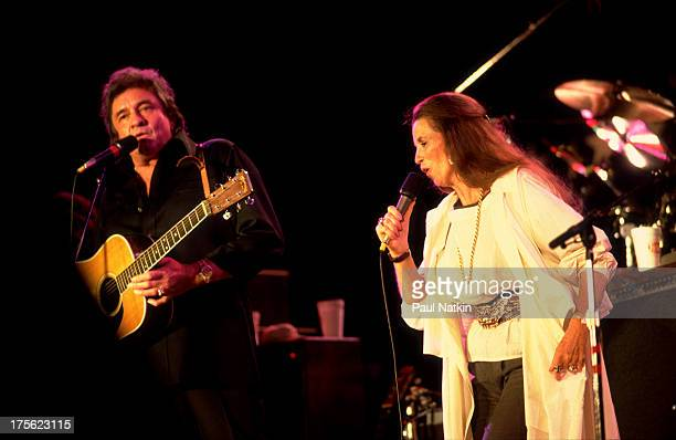 Johnny Cash with June Carter Cash at the first Farm Aid concert held at Memorial Stadium Champaign Illinois September 25 1985