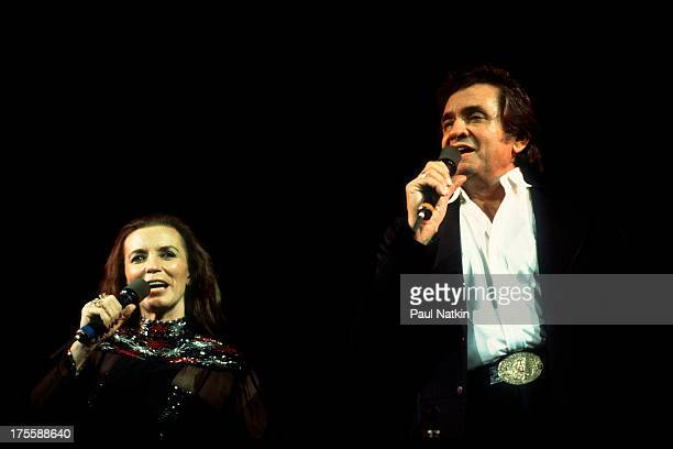 Johnny Cash with June Carter Cash performing at the Dane County Coliseum Madison Wisconsin February 18 1982