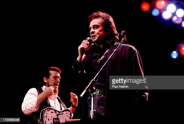Johnny Cash with Waylon Jennings at the first Farm Aid concert, held at Memorial Stadium, Champaign, Illinois, September 25, 1985.