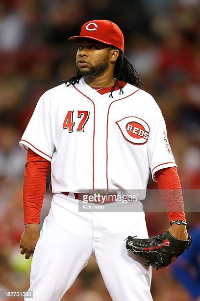 Johnny Cueto of the Cincinnati Reds prepares to pitch during the game against the New York Mets sat Great American Ball Park on September 23 2013 in...