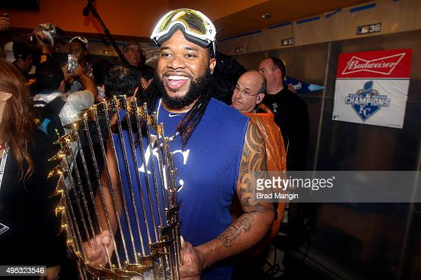 Johnny Cueto of the Kansas City Royals celebrates with the Commissioner's trophy in the locker room after winning Game 5 of the 2015 World Series 72...