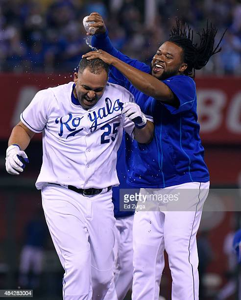 Johnny Cueto of the Kansas City Royals pours water over the head of Kendrys Morales of the Kansas City Royals as they celebrate a 43 win over the Los...