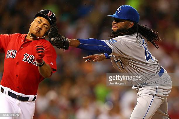 Johnny Cueto of the Kansas City Royals tags out Mookie Betts of the Boston Red Sox attempting to reach first base in the sixth inning on August 21...