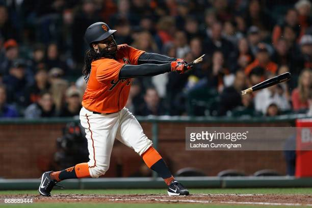 Johnny Cueto of the San Francisco Giants breaks his bat while at bat in the fourth inning against the Colorado Rockies at ATT Park on April 14 2017...