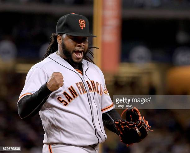 Johnny Cueto of the San Francisco Giants celebrates the third out of the eighth inning on Andrew Toles of the Los Angeles Dodgers at Dodger Stadium...