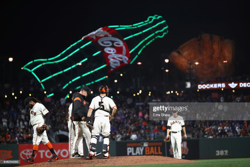 Johnny Cueto #47 of the San Francisco Giants is taken out of the game by manager Bruce Bochy in the fourth inning against the Los Angeles Dodgers at AT&T Park on September 12, 2017 in San Francisco, California.