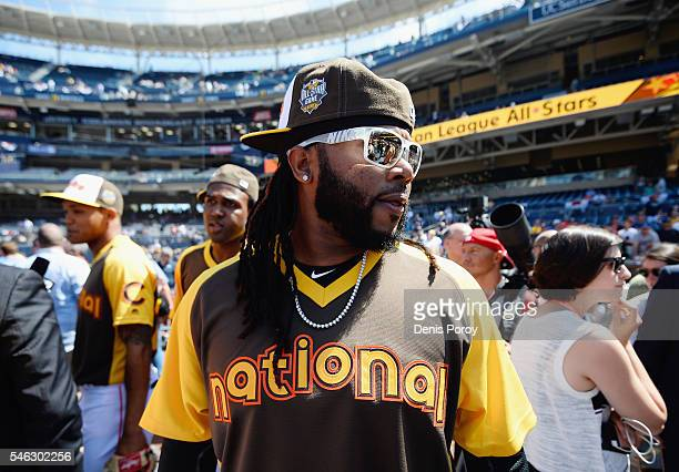 Johnny Cueto of the San Francisco Giants looks on during Gatorade AllStar Workout Day for the 87th Annual MLB AllStar game at PETCO Park on July 11...
