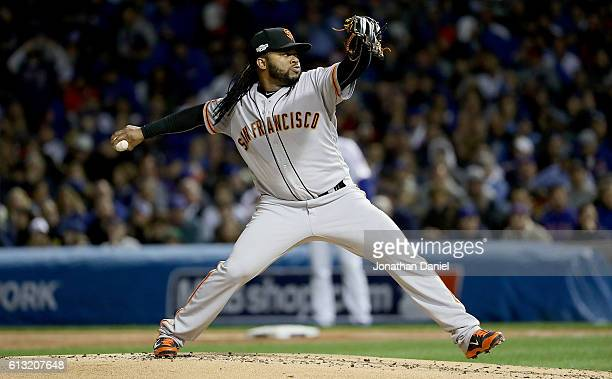 Johnny Cueto of the San Francisco Giants pitches in the first inning against the Chicago Cubs at Wrigley Field on October 7 2016 in Chicago Illinois