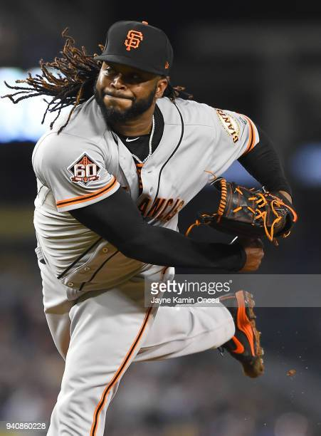 Johnny Cueto of the San Francisco Giants pitches in the game against the Los Angeles Dodgers at Dodger Stadium on March 30 2018 in Los Angeles...