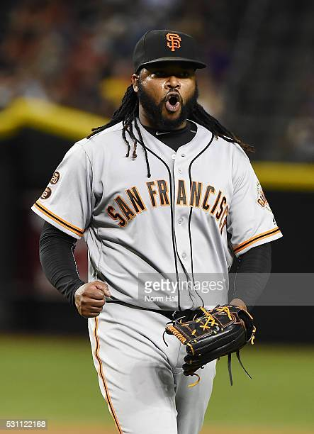 Johnny Cueto of the San Francisco Giants reacts after striking out Paul Goldschmidt of the Arizona Diamondbacks during the seventh inning at Chase...