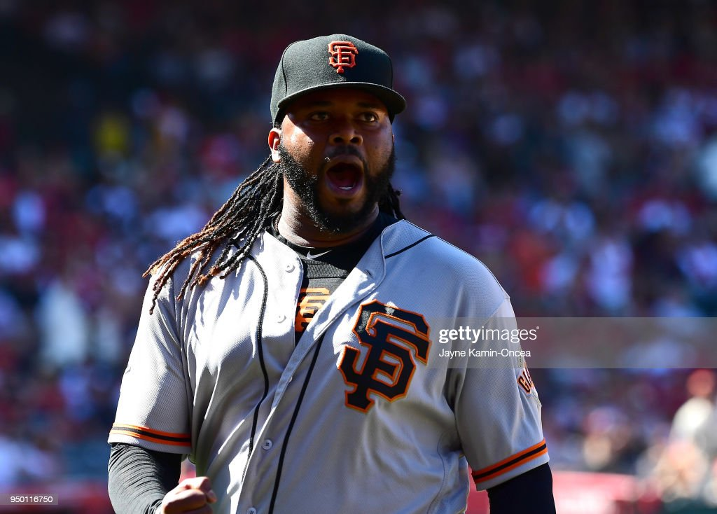 Johnny Cueto #47 of the San Francisco Giants reacts as he returns to the dugout after forcing Luis Valbuena #18 of the Los Angeles Angels of Anaheim to hit into a double play to end a bases loaded threat in the sixth inning of the game at Angel Stadium on April 22, 2018 in Anaheim, California.