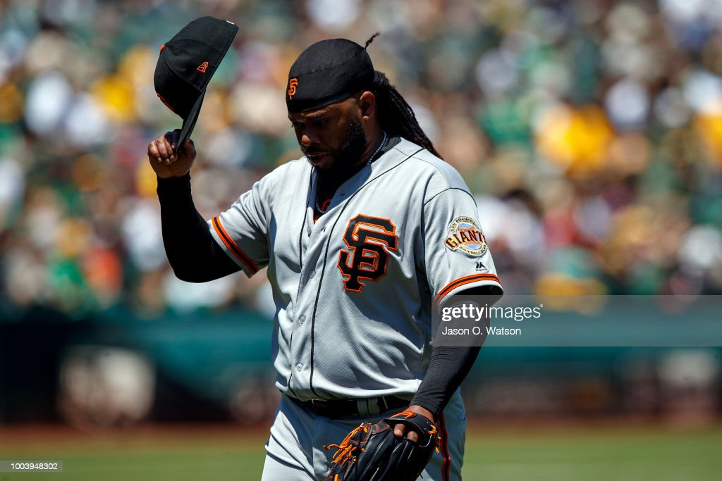 Johnny Cueto #47 of the San Francisco Giants returns to the dugout during the first inning against the Oakland Athletics at the Oakland Coliseum on July 22, 2018 in Oakland, California.