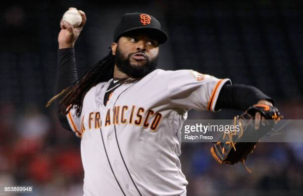 Johnny Cueto of the San Francisco Giants throws a pitch against the Arizona Diamondbacks during the first inning of a MLB game at Chase Field on...