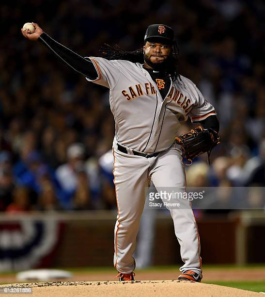 Johnny Cueto of the San Francisco Giants throws to first base in the first inning against the Chicago Cubs at Wrigley Field on October 7 2016 in...