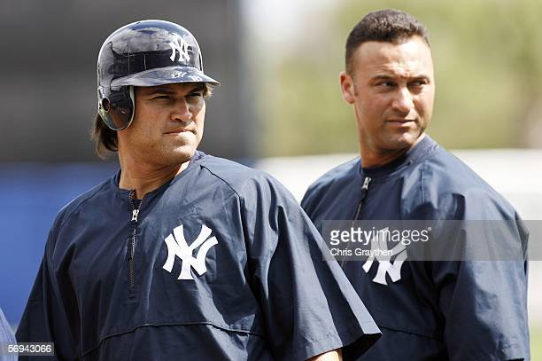 Johnny Damon and Derek Jeter of the New York Yankees look at the crowd during practice on February 26, 2006 at Legends Field in Tampa, Florida.