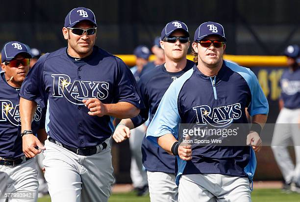 Johnny Damon and Evan Longoria stretch during the Rays spring training work out at the Charlotte Sports Park in Port Charlotte Florida