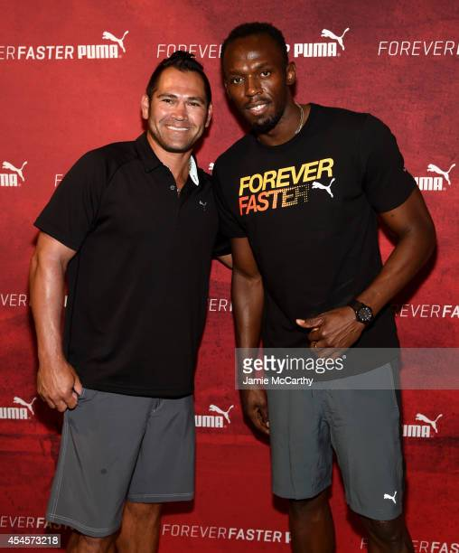 Johnny Damon and Usain Bolt attend The PUMA Store In Soho Training Event on September 3 2014 in New York City