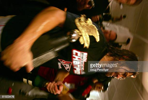 Johnny Damon of the Boston Red Sox celebrates with the ALCS championship trophy after defeating the New York Yankees 103 to win game seven of the...