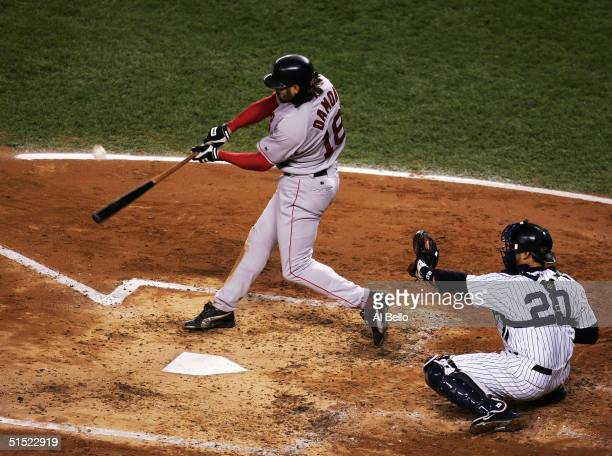 Johnny Damon of the Boston Red Sox hits a grand-slam home run in the second inning against the New York Yankees during game seven of the American...