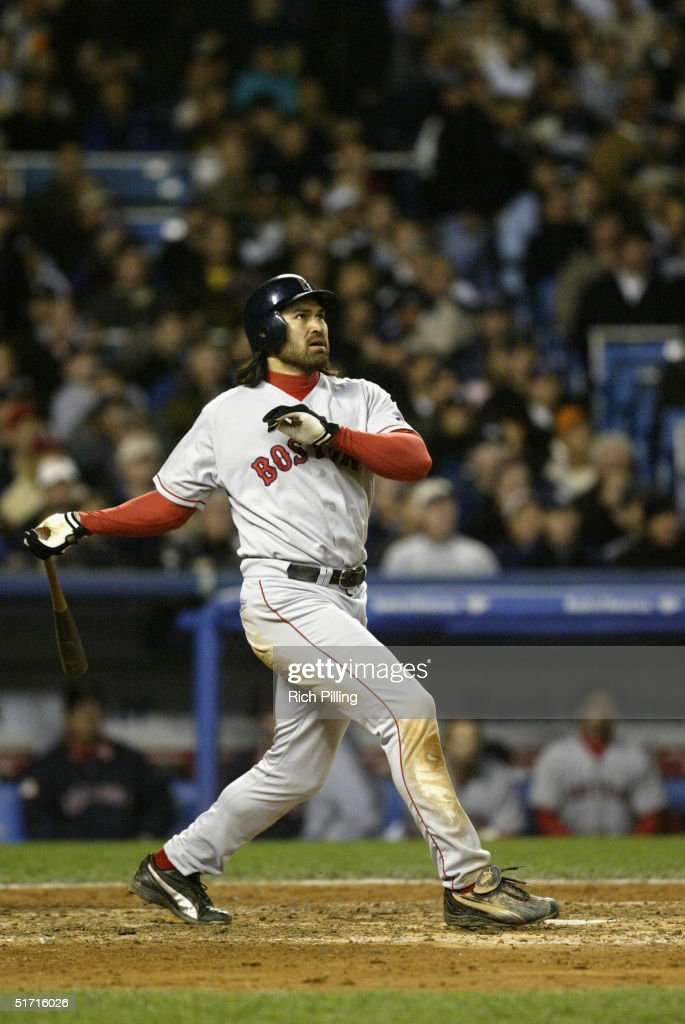 Johnny Damon of the Boston Red Sox hits a two run home run in the fourth inning during game seven of the ALCS against the New York Yankees at Yankee Stadium on October 20, 2004 in the Bronx, New York. The Red Sox defeated the Yankees 10-3 to win the series four games to three.