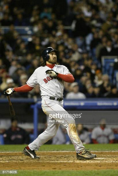Johnny Damon of the Boston Red Sox hits a two run home run in the fourth inning during game seven of the ALCS against the New York Yankees at Yankee...