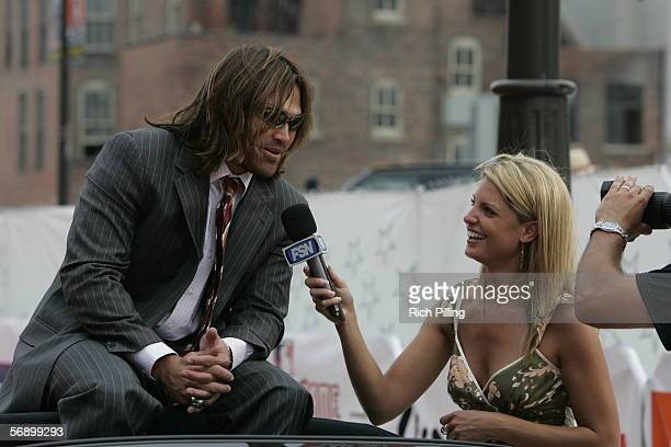 Johnny Damon of the Boston Red Sox is interviewed by Fox Sports reporter Carolyn Hughes on the All-Star Game Red Carpet during All-Star Week at...