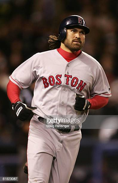 Johnny Damon of the Boston Red Sox runs to first base after hitting a tworun home run in the fourth inning against the New York Yankees during game...