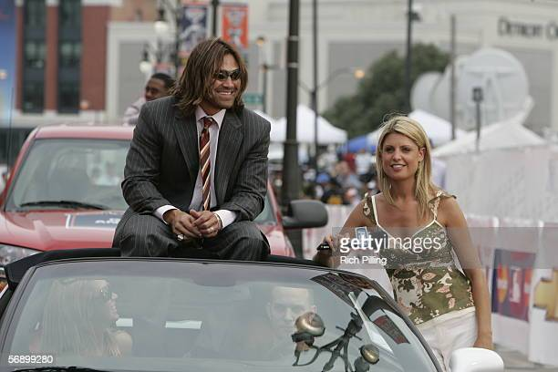 Johnny Damon of the Boston Red Sox waits to be interviewed by Fox Sports reporter Carolyn Hughes on the All-Star Game Red Carpet during All-Star Week...