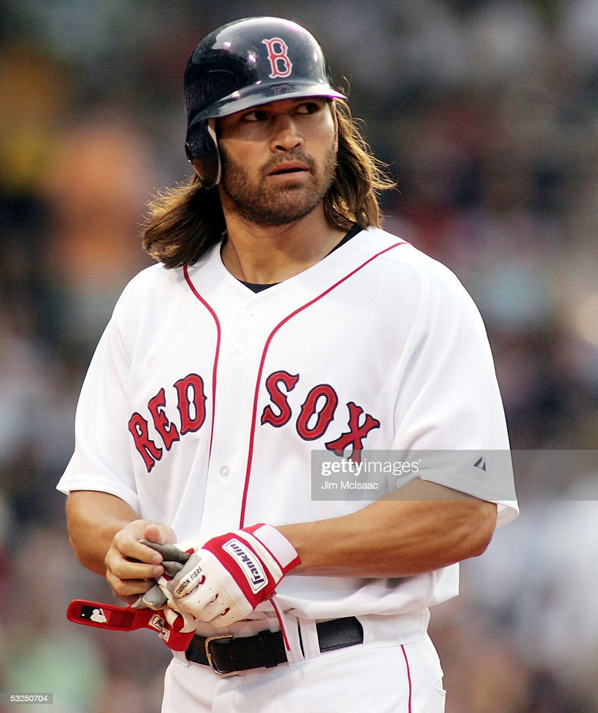 Johnny Damon #18 of the Boston Red Sox walks back to the dugout after flying out against the New York Yankees during their game at Fenway Park on July 17, 2005 in Boston, Massachusetts. The Yankees defeated the Red Sox 5-3.