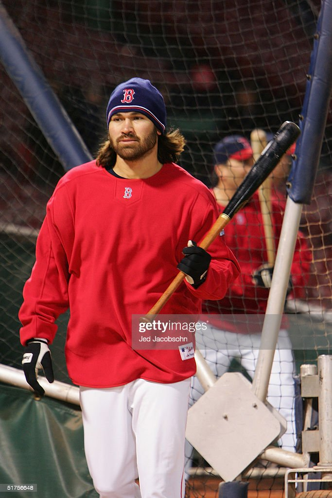 Johnny Damon #18 of the Boston Red Sox warms up before game one of the World Series against the St. Louis Cardinals on October 23, 2004 at Fenway Park in Boston, Massachusetts.