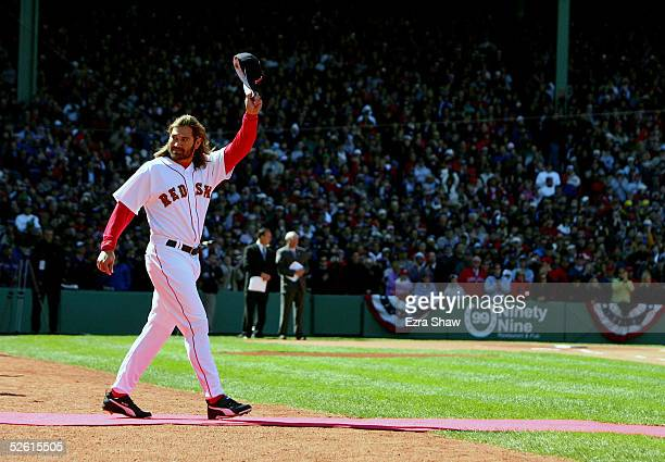 Johnny Damon of the Boston Red Sox waves to the crowd as he goes out to receive his 2004 World Series Championship ring before their game against the...