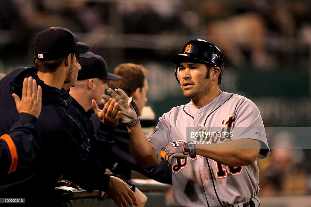 Johnny Damon #18 of the Detroit Tigers is congratulated by teammates after he scored on a double by Casper Wells in the seventh inning to give the Tigers a 4-0 lead in their game against the Oakland Athletics at the Oakland-Alameda County Coliseum on May 19, 2010 in Oakland, California.